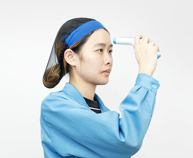 a female worker is testing a thermometer 's function
