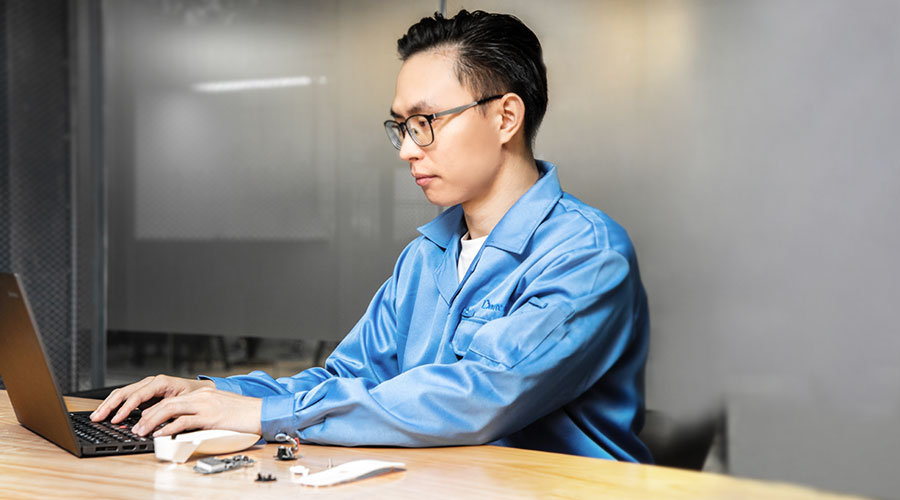 an engineer in blue suit working with a computer